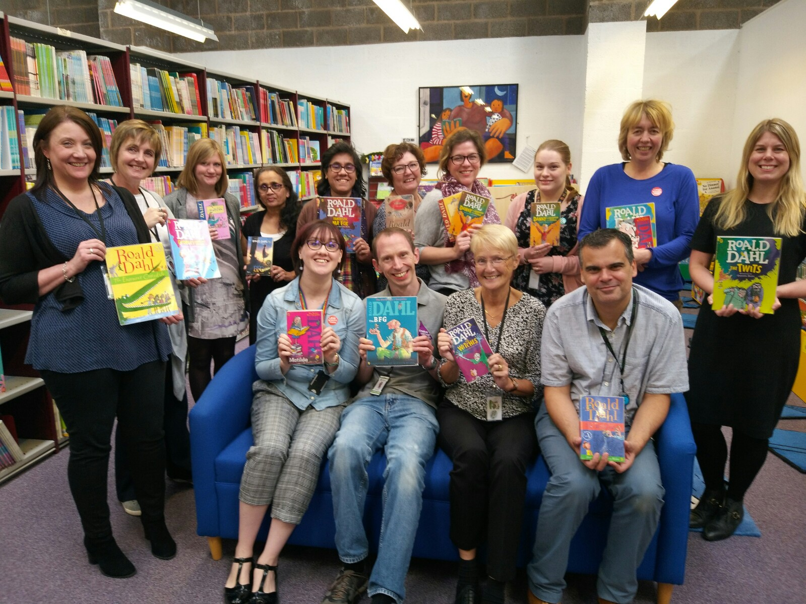 Library staff holding Roald Dahl books